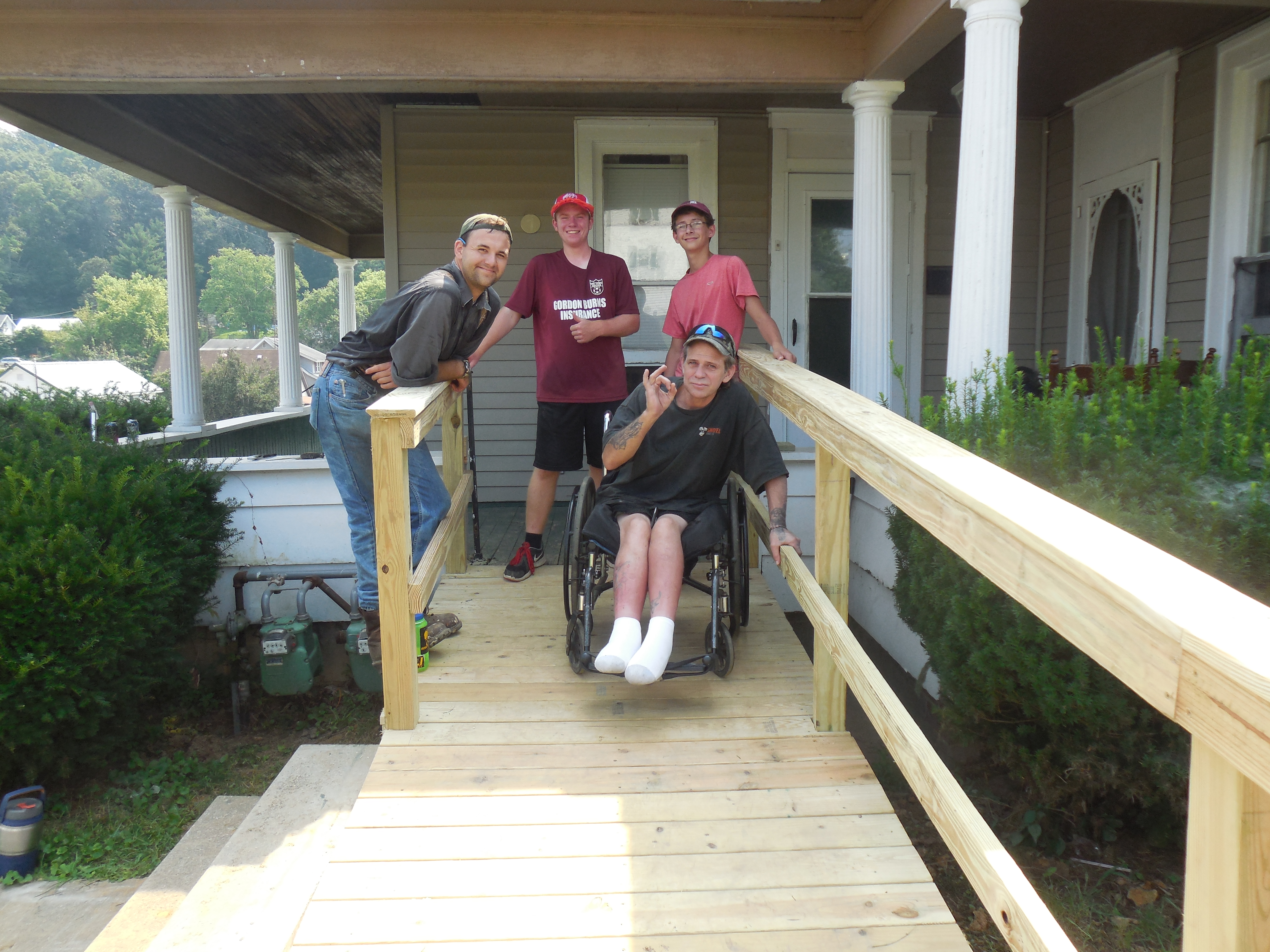 Summer service internship good works inc led by andrew bissell pictured left wesley umc from new hampshire constructed a ramp for a man in glouster fandeluxe Image collections