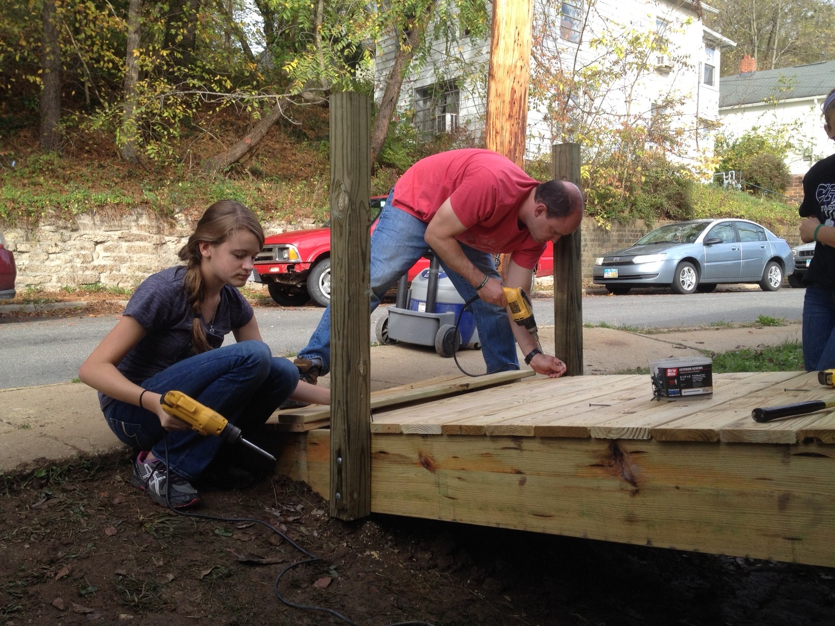 Mike Vanderwoude with daughter Grace putting down the new decking on a ramp for a woman in Athens.